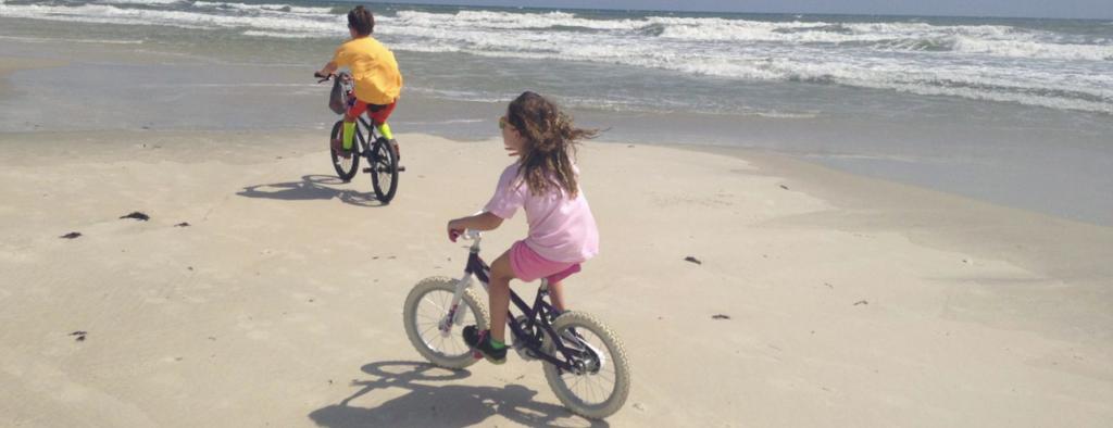 riding bikes on the beach